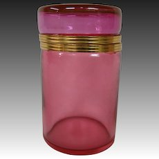 Cranberry glass cylindrical covered dresser box