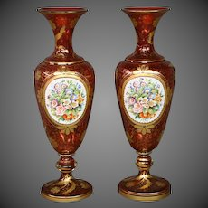 Bohemian cranberry overlay pair of tall hand painted floral pedestal form vases late 1800's