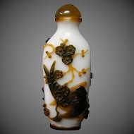 Peking cameo glass snuff bottle birds perched on flowering branches triple overlay
