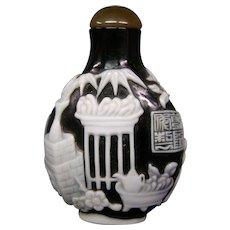 Peking cameo glass snuff bottle black over white vase plants vessels