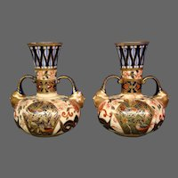 Royal Crown Derby porcelain pair cobalt blue gilded imari handled face vases