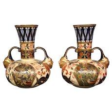 Royal Crown Derby porcelain pair cobalt blue gilded imari handled face vases