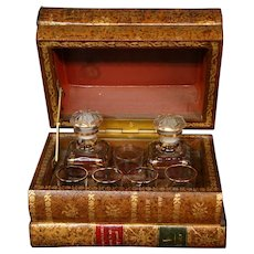 French liquor tantalus decanter set leather books Moliere comedies