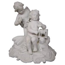 Antique German porcelain bisque parian ware cupids holding birdcage signed