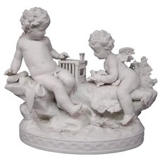German bisque parian ware figurine cupids catching birds birdcage marked