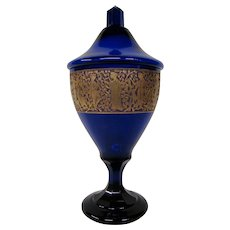 Haida Bohemian art glass cobalt blue covered urn jar gold cameo frieze signed