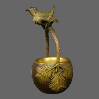 Antique Austrian cold painted bronze bird perched on branches basket leaves