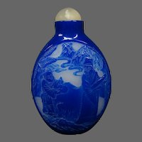 Peking cameo glass snuff bottle deep blue with scenic medallions