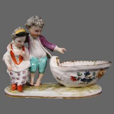 Antique German porcelain figural boy girl salt crossed swords mark