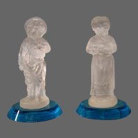 Antique frosted glass pair figurines boy girl blue bases unusual