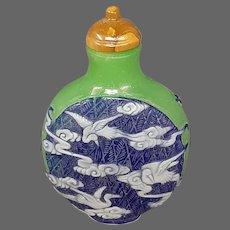 Peking cameo glass apple green deep blue storks in flight snuff bottle