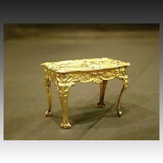 Silver miniature ornate cupid table