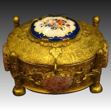 Gilded dresser box with porcelain and stone insets