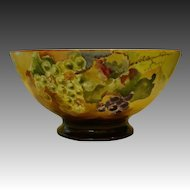 Limoges large hand painted footed punch bowl grapes