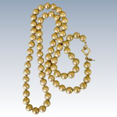 Trifairi Engraved Gold Tone Bead Necklace