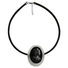 Upcycled Carved Lucite with Black Plastic Cameo Brooch now a Floating Pendant Cord Necklace