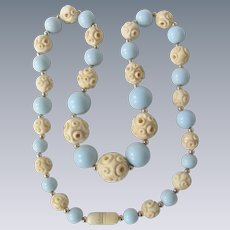 Little Creations Light Blue Galalith Beads and Carved Bone Bead Necklace