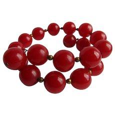 Art Deco Red Bakelite Wrap Around Memory Bead Bracelet