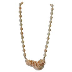 "Exquisite Carved Coral Pendant on Angel Skin Coral 20"" necklace, weighing 58 grams"