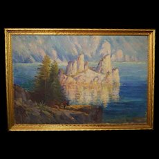 Harry Cassie Best oil painting featuring two figures, a rocky island, a large lake and pine trees