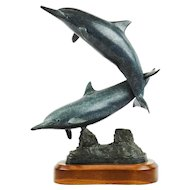 "Randy Puckett (b. 1946) bronze sculpture of two dancing dolphins, titled ""Spinners"", dated 1987"