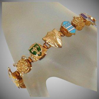 European Souvenir Charm Bracelet. French Fleur-de-Lis Bracelet. Gilded Coat of Arms Souvenir Bracelet.