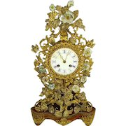 French 19th century Ormolu/Dore Bronze Clock:French Porcelain Flowers