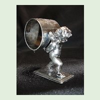 Figural Napkin Ring, Cupid Carrying Ring