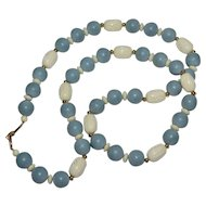 Napier Long Blue & Carved Cream White Bead Necklace