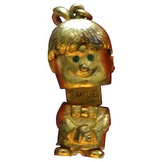 1960s MONET Mechanical 'SMILE' Boy w/ Green Rhinestone Eyes Movable 3D Charm