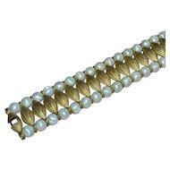1960s Trifari Cleopatra Egyptian Revival Pearlescent White Bead Goldtone Bracelet