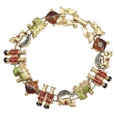Avon Signed Enamel Christmas Toy Soldier, Rocking Horse & Train Slider Charm Bracelet