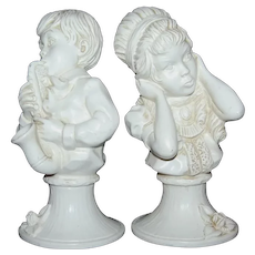 c1971 Universal Statuary Noisy Boy w/ Saxophone & Girl Covering Ears Pair of Figural Sculptures by Artist V. Kendrick