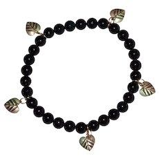 Black Hills Signed 10k Gold Leaf Charm & Black Onyx Bead Stretch Bracelet