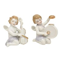 c1950s Pair of White Porcelain Cherub Angels Playing Violin & Drum Musical Instrument Figurines