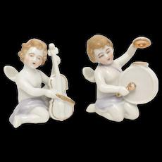 c1950s Pair of White Porcelain Cherub Angels Playing Violin & Drum Musical Instrument Figurines