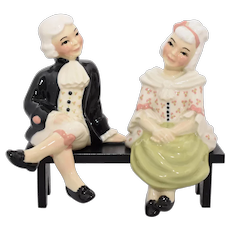 Pair of Mid-Century Ceramic Arts Studio Shelf Sitters of Colonial Gentleman & Lady in 18th Century Fashion Figurines