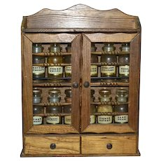 c1970s Set of 12 Primitive Apothecary Glass Spice Jars w/ Original Farmhouse Inspired Solid Wood Cabinet