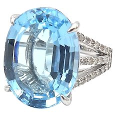 14kt White Gold, Diamond, and Blue Topaz Ring  19+. Carats