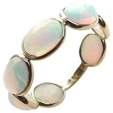 18K Gold Ethiopian Opal Eternity Band Size 7
