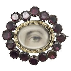 10kt Gold Lover's Eye Brooch with Flat Cut Garnets, circa 1820