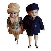 """Girl and boy 3 3/4"""" German All Bisque Dolls Glass Eyes in Wonderful Costumes"""