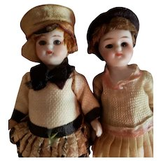 """A Pair of 3 3/4"""" German All Bisque Dolls in Wonderful Costumes"""