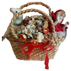 """4"""" Wide Basket Holding Flowers, Lamb and Tiny Doll"""