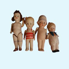 4 Stone Bisque Dolls Nippon Painted Eyes