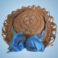 Straw Hat with Blue Ribbon Decoration