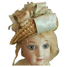 Straw Hat with Pale Blue Ribbon and Flower Decoration