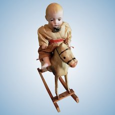 Paper Mache Rocking Horse with Tiny All Bisque Boy