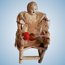 Tiny  Stone Bisque Doll in Bentwood Chair