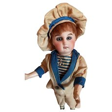 """9"""" Bisque Head Boy in Factory Outfit"""
